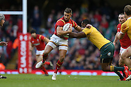 Rhys Webb of Wales is tackled by Tevita Kuridrani of Australia. Under Armour 2016 series international rugby, Wales v Australia at the Principality Stadium in Cardiff , South Wales on Saturday 5th November 2016. pic by Andrew Orchard, Andrew Orchard sports photography