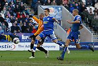 Photo: Steve Bond/Richard Lane Photography. <br />Leicester City v Hull City. Coca Cola Championship. 21/03/2008. Caleb Folan (L) shoots and scores despite Joe Mattock (C)