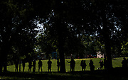 Residents wait in line during a pop up grocery event at Powderhorn Park in Minneapolis, Minnesota, U.S., on Friday, July 24, 2020. Photographer: Ben Brewer/Bloomberg