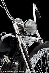 """Dan """"Bacon"""" Carr of DC Choppers' black '48 panhead. Photographed by Michael Lichter in Sturgis SD, on August 13. ©2016 Michael Lichter."""