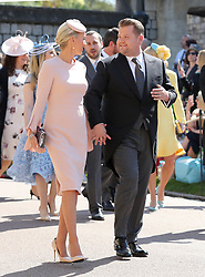 James Cordon and Julia Carey arrive at St George's Chapel at Windsor Castle for the wedding of Meghan Markle and Prince Harry.