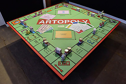 "© Licensed to London News Pictures. 06/10/2017. London, UK.  ""Artopoly"" an art-inspired version of Monopoly by Dean Zeus Colman at the Moniker Art Fair, the world's biggest urban art fair, taking place at the Old Truman Brewery in East London from 5 to 8 October 2017.  The fair brings together the world's most influential new-contemporary and urban art galleries to show international artworks to Londoners. Photo credit : Stephen Chung/LNP"