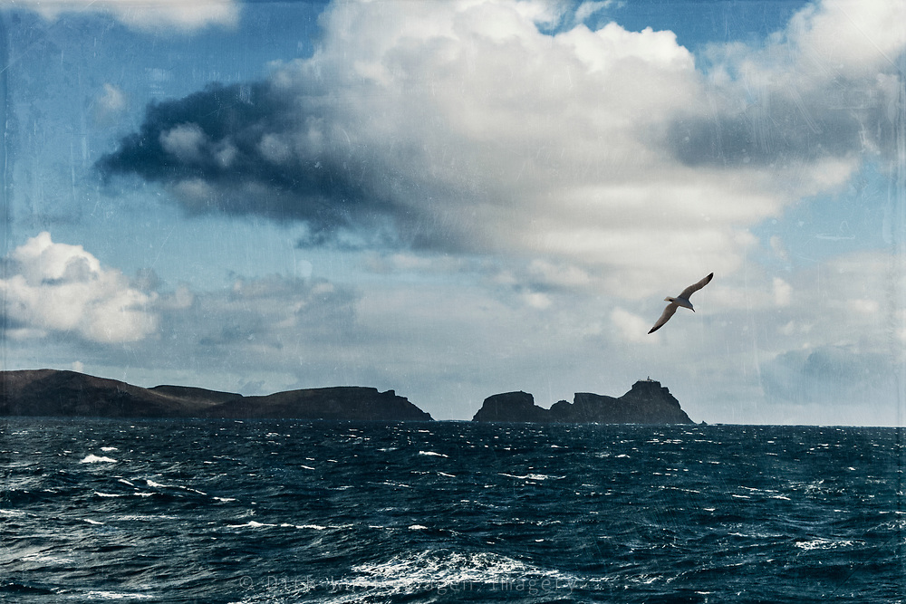 The peninsula Cabo de Sao Lourenco od the island Madeira seen from a sea ferry during a stormy voyage. Photograph edited with texture overlays