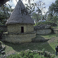 Travelers admire a reconstructed circular house at Kuelap, an ancient stronghold of the pre-Incan Chachapoyan culture that dominated northern Peru about 600 years ago.
