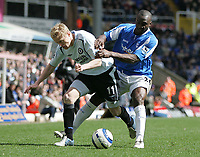 Photo: Lee Earle.<br /> Birmingham City v Chelsea. The Barclays Premiership. 01/04/2006. Chelsea's Damien Duff (L) battles with Olivier Tebily.