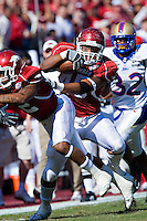 FAYETTEVILLE, AR - NOVEMBER 1:   D.J. Williams #45 of the Arkansas Razorbacks runs with the ball after making a catch against the Tulsa Golden Hurricanes at Donald W. Reynolds Stadium on November 1, 2008 in Fayetteville, Arkansas.  The Razorbacks defeated the Golden Hurricanes 30 to 23.  (Photo by Wesley Hitt/Getty Images) *** Local Caption *** D.J. WilliamsUniversity of Arkansas Razorback Men's and Women's athletes action photos during the 2008-2009 season in Fayetteville, Arkansas....©Wesley Hitt.All Rights Reserved.501-258-0920.