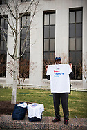 "Emond Allen sells t-shirts he made that read ""Love Trumps hair"".<br />