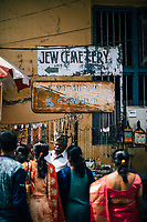Fort Kochi, India -- February 13, 2018: A man sells necklaces and charms on the street in Mattancherry, also known as Jew Town--the original Jewish settlement in Fort Kochi.
