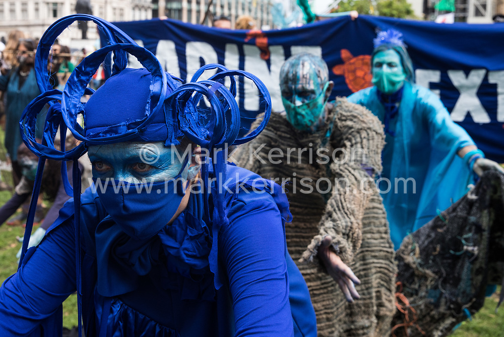 London, UK. 6th September, 2020. Blue rebels join fellow climate activists from the Ocean Rebellion and Extinction Rebellion preparing to take part in a colourful Marine Extinction March. The activists, who are attending a series of September Rebellion protests around the UK, are demanding environmental protections for the oceans and calling for an end to global governmental inaction to save the seas.