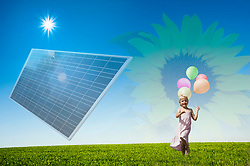 Girl running with bunch of balloons in a field solar panel, Bavaria, Germany