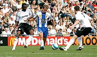 Photo: Steve Bond.<br />Derby County v RCD Espanyol. Pre Season Friendly. 04/08/2007.Albert Riera goes for goal between David Jones (R) and Claude Davis (L)
