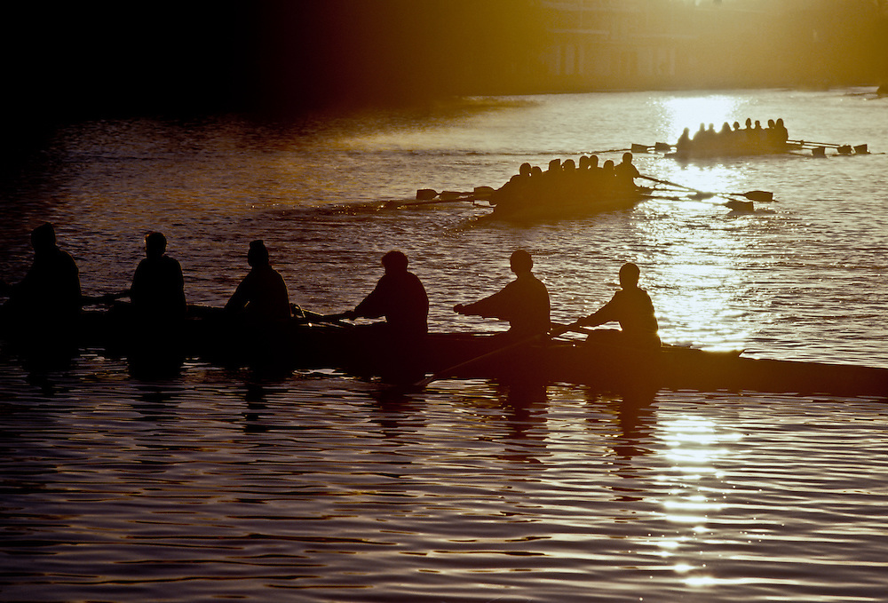 A crew team rowing in the early morning.