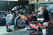 Motorcycle builders at Brass Ball Bobbers in Oklahoma City busy building new production motorcycles.