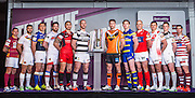 Picture by Alex Whitehead/SWpix.com - 01/02/2015 - Rugby League - 2015 First Utility Super League Launch - Victoria Warehouse, Manchester, England - The twelve Super League club captains and representatives line-up for a photo to preview the 2015 season, from left, Huddersfield's Danny Brough, Catalans' Mathias Pala, Leeds' Kevin Sinfield, Wakefield's Danny Kirmond, Salford's Harrison Hansen, Hull FC's Gareth Ellis, Castleford's Michael Shenton, Warrington's Joel Monaghan, Hull KR's Terry Campese, St Helens' Jon Wilkin, Widnes' Kevin Brown and Wigan's Matty Smith.