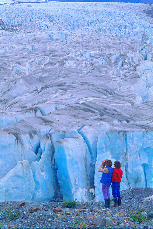 USA Glacier Bay National Park<br /> ALASKA<br /> <br /> Two women looking out over Alsek Glacier, Alsek River