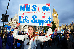 **Junior doctors in England have today (19/11/2015) voted in favour of strike action in a dispute over Government's proposed changes to work and pay contracts** FILE PICTURE © Licensed to London News Pictures. 17/10/2015. London, UK. Junior doctors and NHS staff protesting against the health service cuts and the proposed contract changes offered by the government outside Parliament in London on Saturday, 17 October 2015. Photo credit: Tolga Akmen/LNP