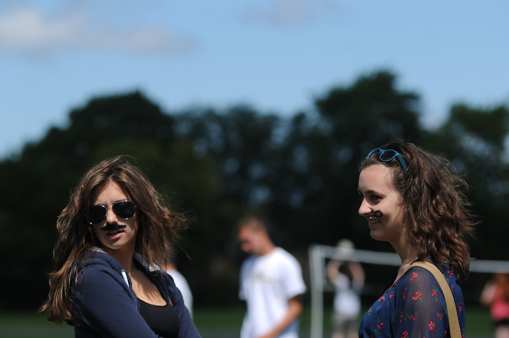 Students Stephanie Kalpedis (L) and Emily Bieniek, 17, sport two styles of mustaches generations apart during a back to school picnic at Resurrection High School celebrating the 90th anniversary of the all-girls College Prep school on Chicago's Northwest side  on August 28, 2011 l Brian J. Morowczynski~ViaPhotos..For use in a single edition of Catholic New World Publications, Archdiocese of Chicago. Further use and/or distribution may be negotiated separately. ..Contact ViaPhotos at 708-602-0449 or email brian@viaphotos.com.   .