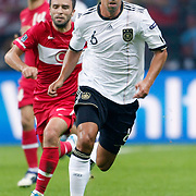 Turkey's Gokhan GONUL (L) and Germany's Sami KHEDIRA (R) during their UEFA EURO 2012 Qualifying round Group A matchday 19 soccer match Turkey betwen Germany at TT Arena in Istanbul October 7, 2011. Photo by TURKPIX