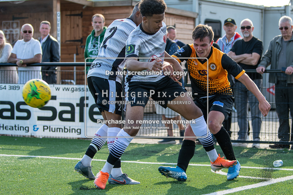 BROMLEY, UK - SEPTEMBER 08: Tom Carlse, of Cray Wanderers FC, manages to get a cross from a tight spot during the Emirates FA Cup First Qualifying Round match between Cray Wanderers FC and Bedfont Sports Club at Hayes Lane on September 8, 2019 in Bromley, UK. <br /> (Photo: Jon Hilliger)