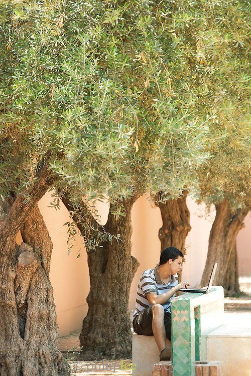 A man uses his laptop and the free wifi of Cyberpark in Marrakech, Morocco