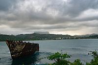 Barge with El Yunque Mountain in the background, Baracoa, Cuba 2020 from Santiago to Havana, and in between.  Santiago, Baracoa, Guantanamo, Holguin, Las Tunas, Camaguey, Santi Spiritus, Trinidad, Santa Clara, Cienfuegos, Matanzas, Havana