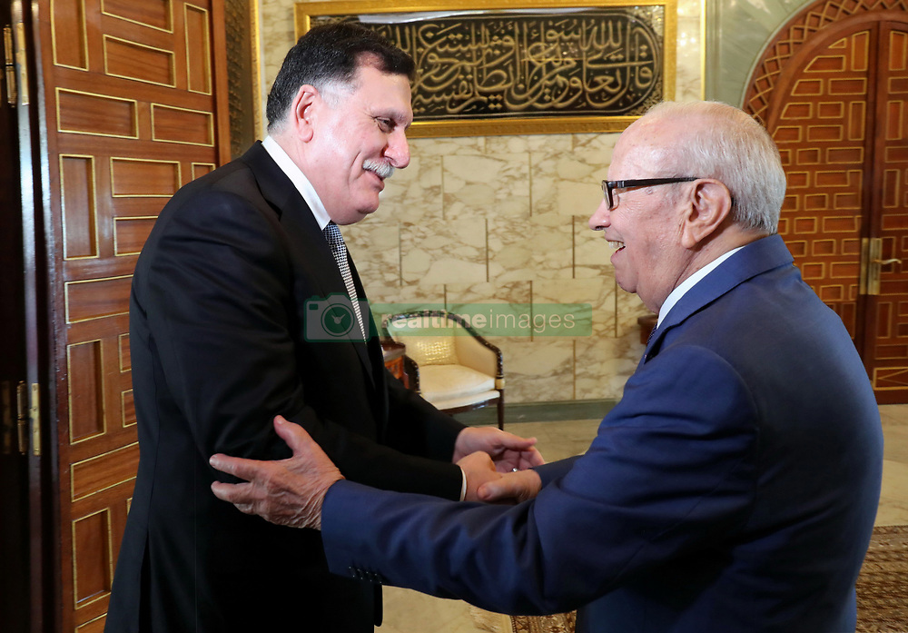 August 7, 2017 - Tunis, Tunisia - The President of the Republic, Béji Caïd Essebsi, received on Monday, August 7, 2017, the President of the Presidential Council and Libyan Prime Minister Fayez Al Sarraj in Carthage..The Head of State reiterated on this occasion the support of Tunisia to Libya, stressing the need to establish a Libyan state as soon as possible. (Credit Image: © Chokri Mahjoub via ZUMA Wire)