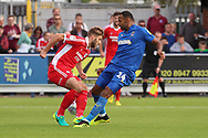 AFC Wimbledon midfielder Liam Trotter (14) battles for possession  during the EFL Sky Bet League 1 match between AFC Wimbledon and Scunthorpe United at the Cherry Red Records Stadium, Kingston, England on 15 September 2018.