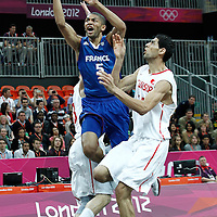 04 August 2012: France Nicolas Batum goes for the layup past Tunisia Salah Mejri during 73-69 Team France victory over Team Tunisia, during the men's basketball preliminary, at the Basketball Arena, in London, Great Britain.