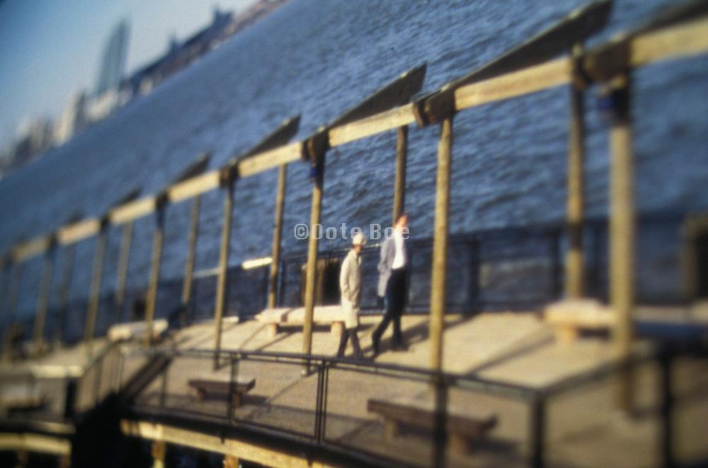2 men walking on a pier
