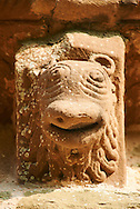 Norman Romanesque exterior corbel no 17 - sculpture of the head of an animal with a lions mane and beak shaped wide mouth. The Norman Romanesque Church of St Mary and St David, Kilpeck Herefordshire, England. Built around 1140 .<br /> <br /> Visit our MEDIEVAL PHOTO COLLECTIONS for more   photos  to download or buy as prints https://funkystock.photoshelter.com/gallery-collection/Medieval-Middle-Ages-Historic-Places-Arcaeological-Sites-Pictures-Images-of/C0000B5ZA54_WD0s