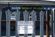 Closed mosque in the inner city area of Lozells under Coronavirus lockdown on 6th May 2020 in Birmingham, England, United Kingdom. Coronavirus or Covid-19 is a new respiratory illness that has not previously been seen in humans. While much or Europe has been placed into lockdown, the UK government has put in place more stringent rules as part of their long term strategy, and in particular social distancing.