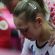 Victoria Komova, Russia, is consoled by her coach after missing out own a medal in the Gymnastics Artistic, Women's Apparatus, Uneven Bars Final at the London 2012 Olympic games. London, UK. 6th August 2012. Photo Tim Clayton
