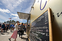Visitors had over a dozen food trucks to choose from during the Exit 20 Food Truck Festival at Tanger Outlet on Saturday.  (Karen Bobotas/for the Laconia Daily Sun)