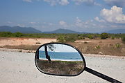 Nabula Beach reflected in a motercycle mirror, Tanintharyi Region, Burma.<br /> endless white sand can be found 18 kilometres north of Maungmagan.<br /> Note: These images are not distributed or sold in Portugal
