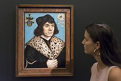 June 29, 2018 - London, UK - A staff member views ''Portrait of a man with a spotted fur collar'' by Lucas Cranach The Elder (Est. £1.5-2m).  Preview of Old Masters, British, Treasures, Sculptures and Ancient works at Sotheby's New Bond Street to be offered for sale on 3 and 4 July 2018. (Credit Image: © Stephen Chung/London News Pictures via ZUMA Wire)