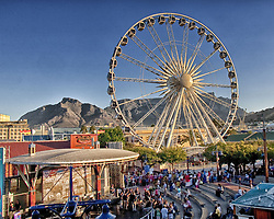 March 19, 2011 - Cape Town, Western Cape, South Africa - The giant Observation Wheel, also known as the Wheel of Excellence, in the Victoria & Alfred Waterfront, historic heart of Cape Town's harbor and South Africa's most-visited tourist destination. In the background are iconic Table Mountain and Devil's Peak. (Credit Image: © Arnold Drapkin/ZUMAPRESS.com)