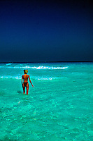 Young woman enjoying the clear, warm waters of the Caribbean Sea, Cancun, Mexico