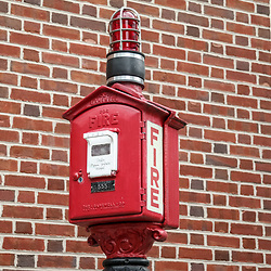 A red fire alarm box at the Sunbury Fire Department Memorial in Sunbury, Pennsylvania