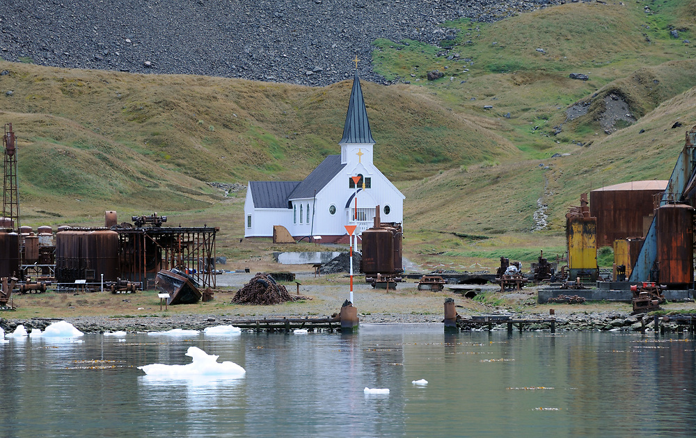 The Norwegian Lutheran Church stands among the rusting ruins of the whaling station. Grytviken, South Georgia 20Feb16