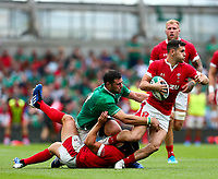 Rugby Union - 2019 pre-Rugby World Cup warm-up (Guinness Summer Series) - Ireland vs. Wales<br /> <br /> Tomos Williams (Wales) in action against Robbie Henshaw (Ireland) at The Aviva Stadium.<br /> <br /> COLORSPORT/KEN SUTTON