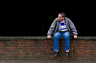 A fan watches on near Loftus Road stadium, Queens Park Rangers, before the EFL Sky Bet Championship match between Queens Park Rangers and Burton Albion at the Loftus Road Stadium, London, England on 23 September 2017. Photo by Richard Holmes.