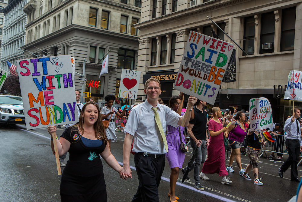 A group of Mormons who support the LGBT community march down 5th Avenue.