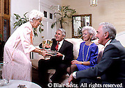 Active Aging Senior Citizens, Retired, Activities, Retired Couples <br /> Enjoy Drinks Together, Pre-dinner Drinks, Social Time with Dinner Guests