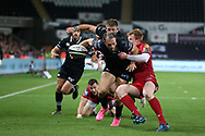 Cory Allen of the Ospreys (14) is tackled just short of the try line by Rhys Patchell of the Scarlets and the ball gets knocked away. Guinness Pro14 rugby match, Ospreys v Scarlets at the Liberty Stadium in Swansea, South Wales on Saturday October 7th 2017. <br /> pic by Andrew Orchard, Andrew Orchard sports photography.