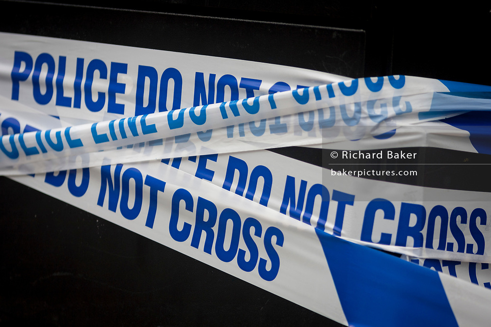 In the aftermath of the London Bridge and Borough Market terrorist attack the previous night, police crime scene tape a half a mile from the location where 7 people were killed and many others injured (Sunday's total). On Sunday 4th June 2017, in the south London borough of Southwark, England. (Photo by Richard Baker / In Pictures via Getty Images)