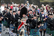 A traditional Scottish pipe band marching during Pipefest Stirling, an event staged at Stirling Castle to coincide with the 700th anniversary of the Battle of Bannockburn. The event was attended by 1600 pipers, Highland dancers and other musicians and formed a procession through the city's streets. The Battle of Bannockburn took place in 1314 and resulted in the defeat of Edward II's English army by the Scots under Bruce.