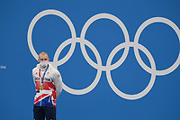 TOKYO, JAPAN - JULY 26: Adam Peaty of Great Britain is seen on the podium with his gold medal after winning the Men's 100m Breaststroke on day three of the Tokyo 2020 Olympic Games at Tokyo Aquatics Centre on July 26, 2021 in Tokyo, Japan<br /> <br /> Credit: COLORSPORT/Ian MacNicol