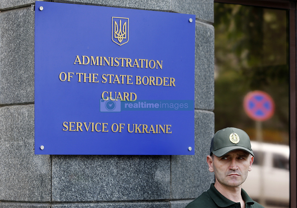 August 8, 2017 - Kiev, Ukraine - A member of the State border Guard Service stands near the enter of Administration of the State border Guard Service of Ukraine building in Kiev, Ukraine, 08 August, 2017. Supporters of the former Georgian president and the former Odessа region Governor Mikheil Saakashvili gathered near Administration of the State border Guard Service of Ukraine to find out the grounds regarding the inadmissibility of Mikheil Saakashvili on the territory of Ukraine. Mikheil Saakashvili has been stripped of his Ukrainian citizenship at the end of July, which made possible his extradition to Georgia. (Credit Image: © Str/NurPhoto via ZUMA Press)