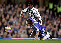 Photo: Marc Atkins.<br /> Chelsea v Newcastle United. The Barclays Premiership. 13/12/2006. Obafemi Martins of Newcastle Utd in action with John Terry of Chelsea.