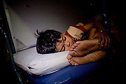 Returning from an 8 day holiday in Srinagar, Kashmir with her parents, four year old Diya shares a berth with her mother in the air-conditioned coach on the Himsagar Express 6318 going from Jammu Tawi station to Kanyakumari on 7th July 2009.. .6318 / Himsagar Express, India's longest single train journey, spanning over 3720 kms, going from the mountains (Hima) to the seas (Sagar), from Jammu and Kashmir state in the Indian Himalayas to Kanyakumari, the southern-most tip of India..Photo by Suzanne Lee / for The National.